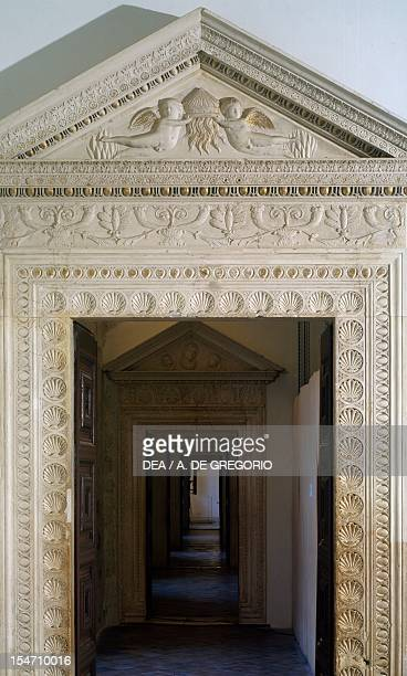 Door with relief decoration on the frame Jole's apartment Ducal Palace Urbino Marche Italy 15th century