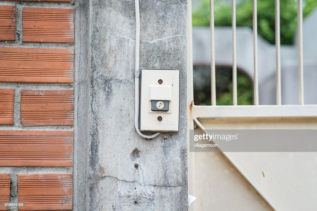 Doorbell side wall : Stock Photo