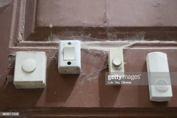 Doorbells buttons on wooden door