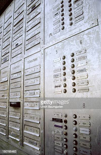 Doorbells of a block of flats, In the background the post boxes, Symbolic picture: anonymity in blocks of flats / big citys.