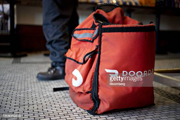 A DoorDash Inc delivery bag sits on the floor at Chef Geoff's restaurant in Washington DC US on Thursday March 26 2020 As the wheels of government...