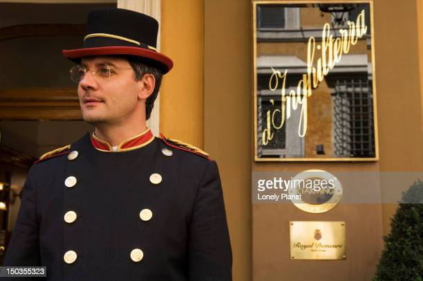 doorman at hotel d'inghilterra in centro storico. - doorman stock photos and pictures