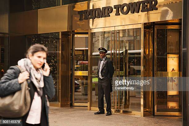 doorman at the trump tower - doorman stock photos and pictures