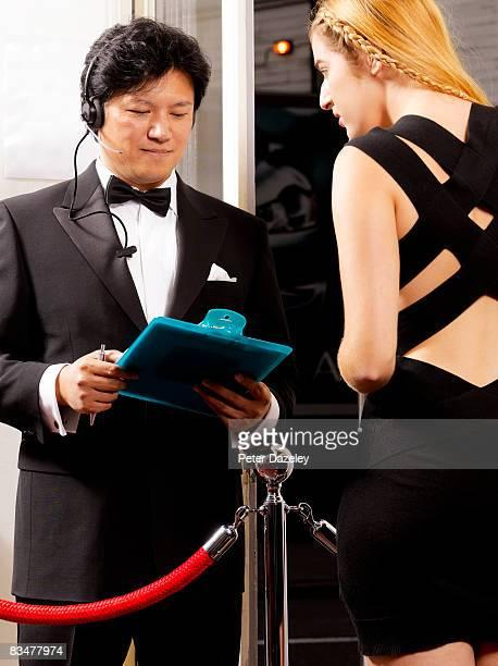 Doorman checking guest list