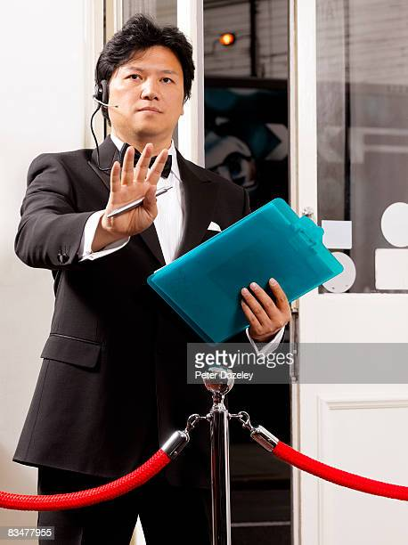doorman gesturing - doorman stock photos and pictures