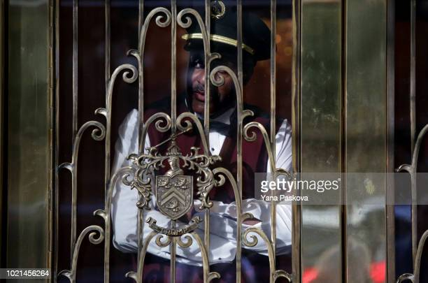 A doorman looks out from the lobby of Trump Park Avenue on August 22 2018 in New York City where President Donald Trump's former lawyer Michael Cohen...