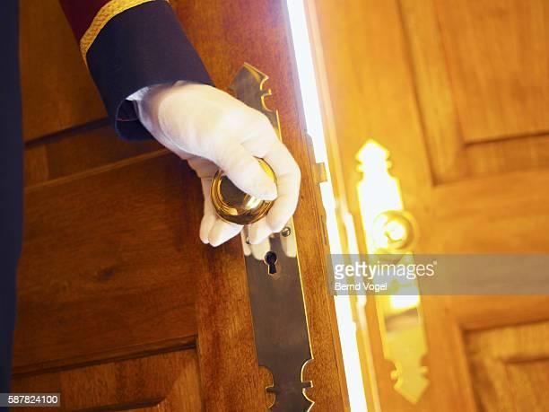 Doorman opening a door