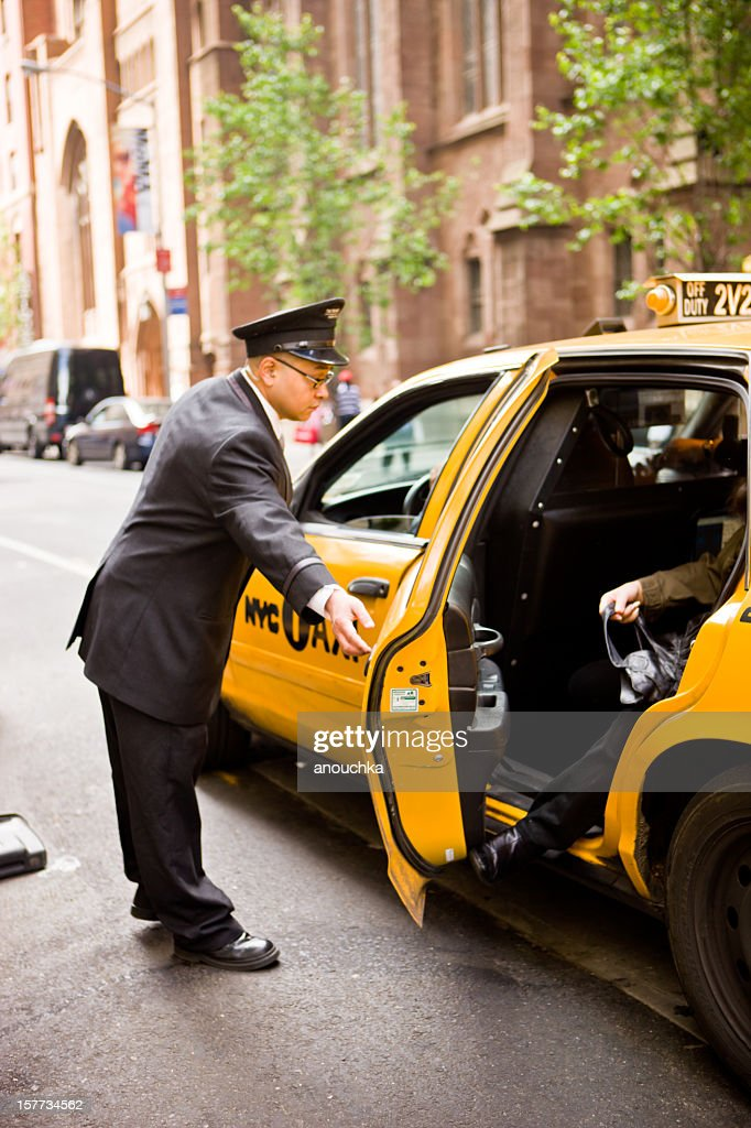 DoorMan opening taxi arriving at New York Hotel : Stock Photo