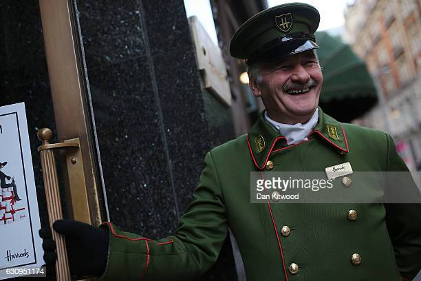 A doorman poses outside Harrods department store on January 4 2017 in London England The union that represents the catering staff at Harrods' onsite...