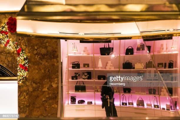 A doorman standing inside an Ivanka Trump brand store is reflected in a mirror at Trump Tower in New York US on Thursday Dec 14 2017 Trump's new...