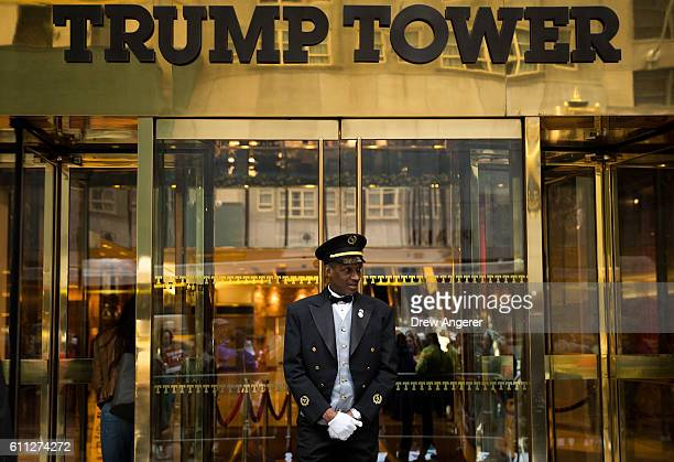A doorman stands at the entrance of Trump Tower as protestors rally against Republican presidential candidate Donald Trump September 29 2016 in New...