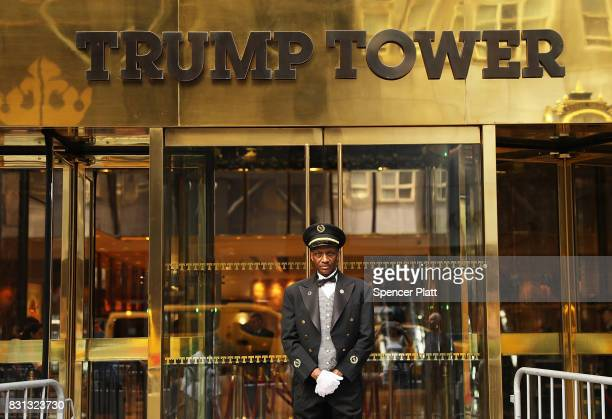 A doorman stands in front of Trump Tower along Fifth Avenue on August 14 2017 in New York City Security throughout the area is high as President...