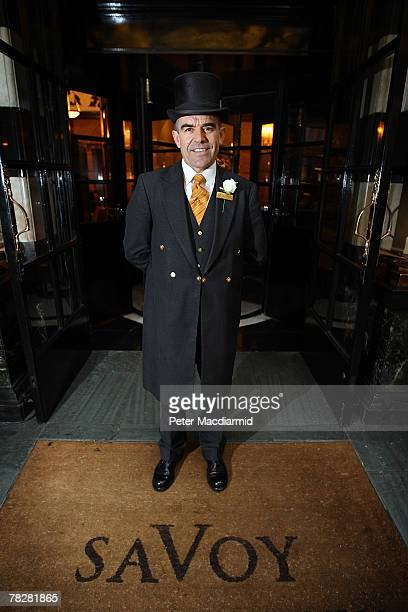 Doorman Tony Cortegaca stands at the entrance to the Savoy Hotel on December 6 2007 in London Some of the fixtures and fittings are to be auctioned...