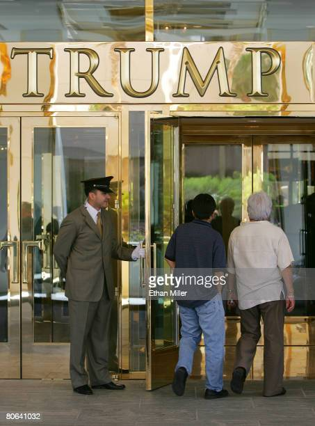 A doorman welcomes guests to the Trump International Hotel Tower Las Vegas after an opening ceremony April 11 2008 in Las Vegas Nevada The 64story...