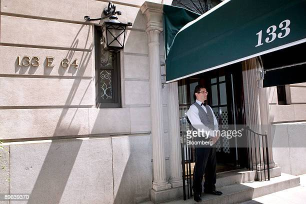 A doorman who declined to be identified stands outside 133 East 64th Street a building that houses the penthouse apartment belonging to Bernard and...