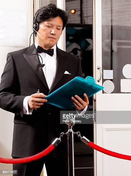 Doorman with guest list