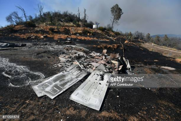 Doors lay in a pile of rubble after a fire tore through a residential neighborhood near Oroville California on July 8 2017 The first major wildfires...