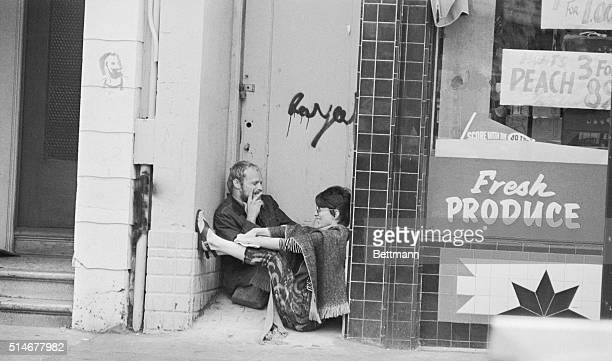 A doorway on Haight Street is home enough for a pair of happy hippies in San Francisco's HaightAshbury district in 1967