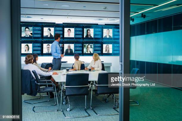 Doorway to video conference in modern conference room