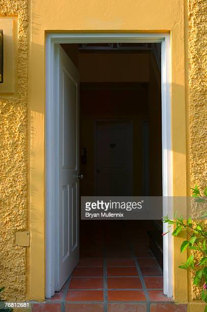 doorway to yellow bungalow, jamaica - ajar stock pictures, royalty-free photos & images
