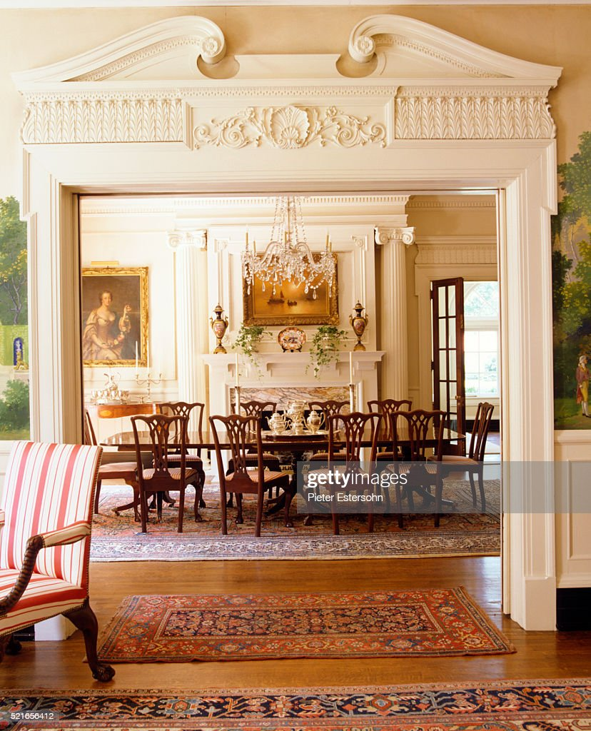 Doorway With Crown Molding Leading Into Formal Dining Room : Stock Photo