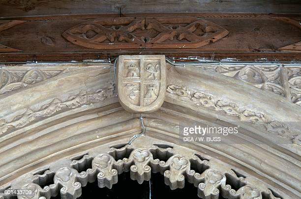 Doorway with reliefs and heraldic symbol Belmonte castle Hill of San Cristobal Belmonte CastileLa Mancha Spain 15th century