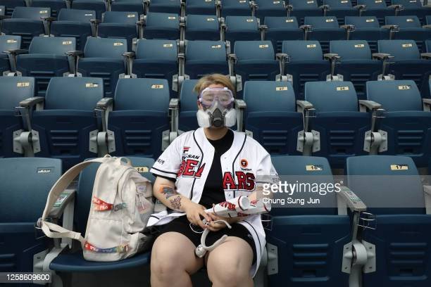 Doosan Bears fan wearing a goggle and mask ahead the KBO League game between LG Twins and Doosan Bears at the Jamsil Stadium on July 26, 2020 in...