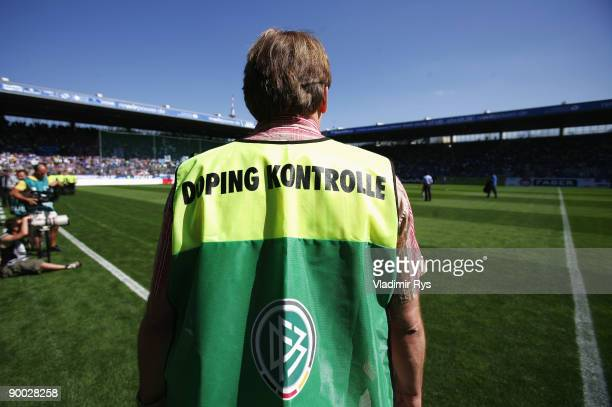 Doping control official stands on a pitch side ahead the Bundesliga match between VfL Bochum and Hertha BSC Berlin at Rewirpower Stadium on August 23...