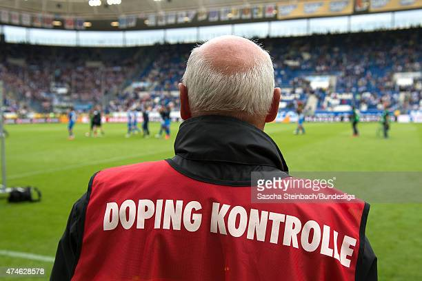 A doping controller waits for players at the end of the Bundesliga match between 1899 Hoffenheim and Hertha BSC Berlin at Wirsol RheinNeckarArena on...