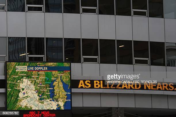 A doppler radar screen is seen on an office building as a snow storm approaches the area on January 22 2016 in WashingtonDC Thousands of flights were...