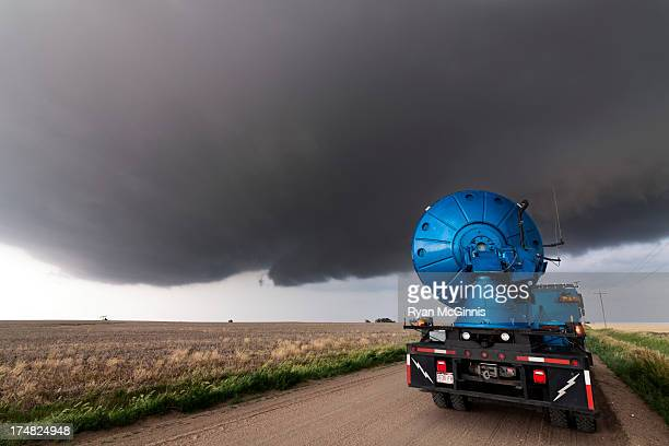 Doppler radar truck with the Center for Severe Weather Research scans a developing supercell thunderstorm near Hays, Kansas, May 25, 2012. These...
