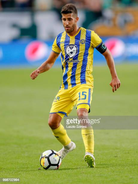 Dor Micha of Maccabi Tel Aviv FC controls the ball during the UEFA Europa League First Qualifying Round 1st Leg match between Ferencvarosi TC and...