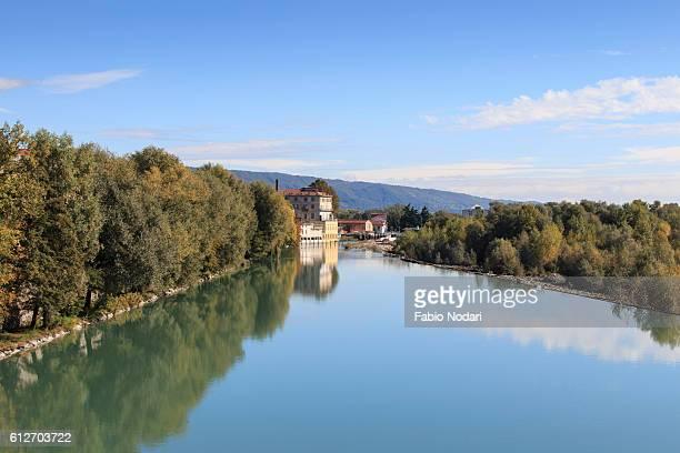 dora baltea river and ivrea cityscape in piedmont, italy - ビエラ ストックフォトと画像