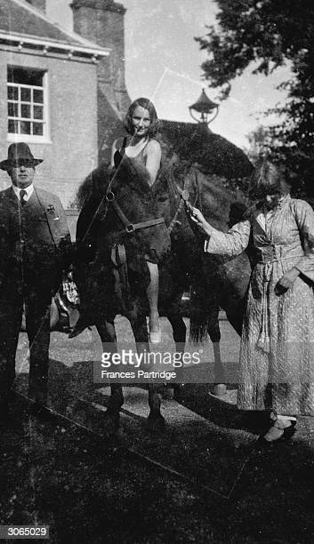 Dora Carrington with Vivien John on a horse at Fryern Court the home of the painter Augustus John