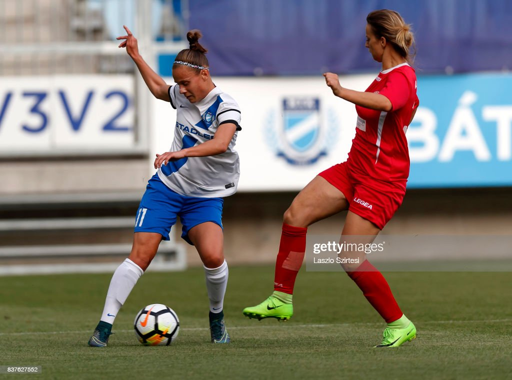 Dora Papp #11 of MTK Hungaria FC dribbles next to Ambra Gjegji (R) of WFC Hajvalia during the UEFA Women's Champions League Qualifying match between MTK Hungaria FC and WFC Hajvalia at Nandor Hidegkuti Stadium on August 22, 2017 in Budapest, Hungary.