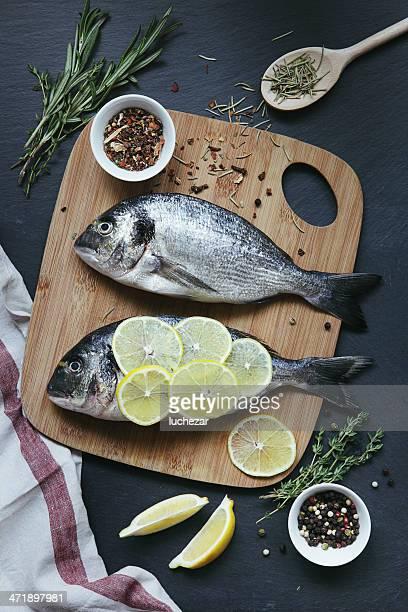 dorado with lemon and spices - dorado fish stock photos and pictures