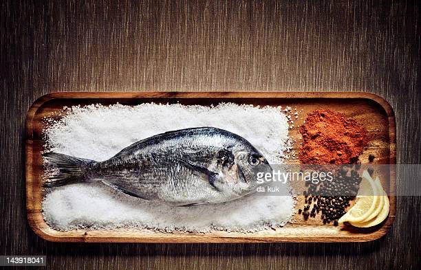 dorado with spices - dorado fish stock photos and pictures
