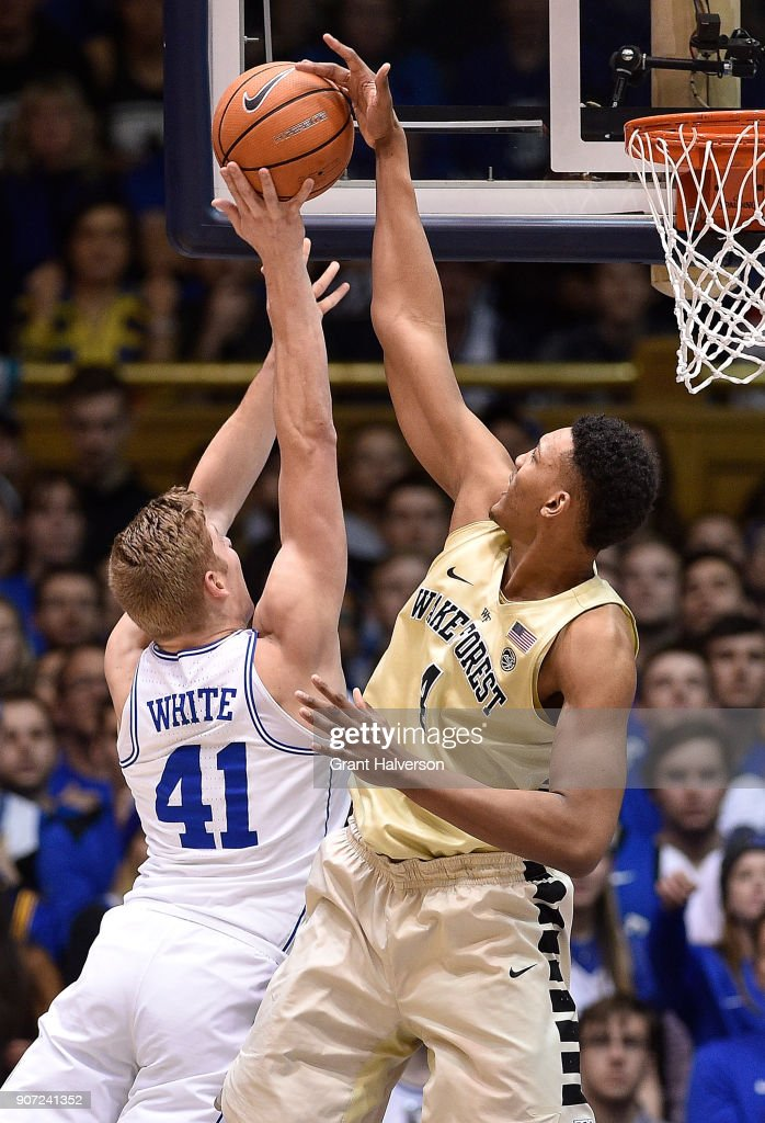 Doral Moore #4 of the Wake Forest Demon Deacons blocks a shot by Jack White #41 of the Duke Blue Devils during their game at Cameron Indoor Stadium on January 13, 2018 in Durham, North Carolina. Duke won 89-71.