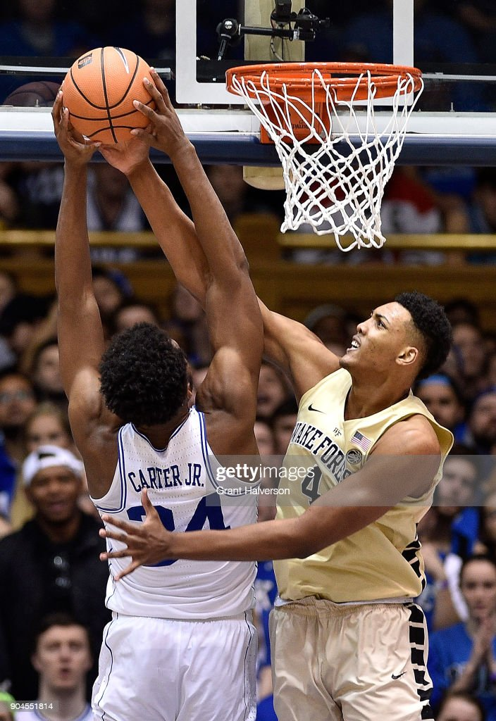 Doral Moore #4 of the Wake Forest Demon Deacons blocks a shot by Wendell Carter Jr #34 of the Duke Blue Devils during their game at Cameron Indoor Stadium on January 13, 2018 in Durham, North Carolina. Duke won 89-71.