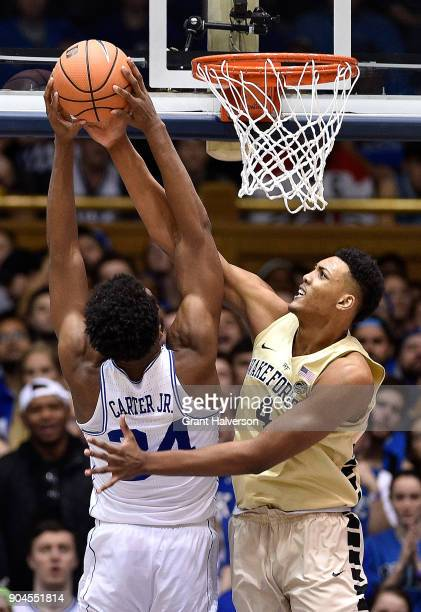 Doral Moore of the Wake Forest Demon Deacons blocks a shot by Wendell Carter Jr of the Duke Blue Devils during their game at Cameron Indoor Stadium...