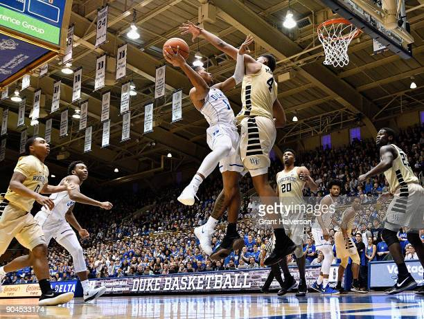 Doral Moore of the Wake Forest Demon Deacons defends a drive by Trevon Duval of the Duke Blue Devils during their game at Cameron Indoor Stadium on...