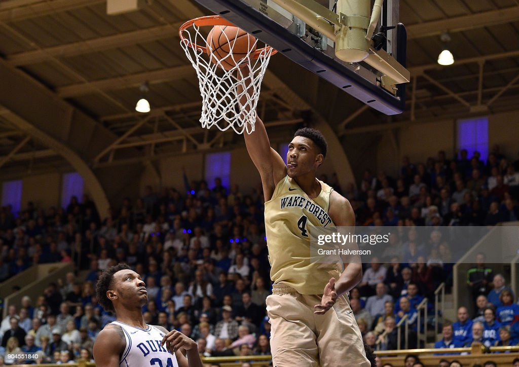 Doral Moore #4 of the Wake Forest Demon Deacons dunks against Wendell Carter Jr #34 of the Duke Blue Devils during their game at Cameron Indoor Stadium on January 13, 2018 in Durham, North Carolina. Duke won 89-71.