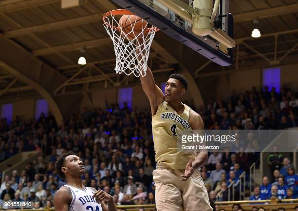 Doral Moore of the Wake Forest Demon Deacons dunks against Wendell Carter Jr of the Duke Blue Devils during their game at Cameron Indoor Stadium on...