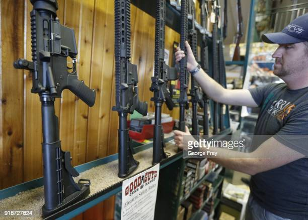 Dordon Brack pulls a semiautomatic AR15 off the rack that is for sale at Good Guys Guns Range on February 15 2018 in Orem Utah An AR15 was used in...