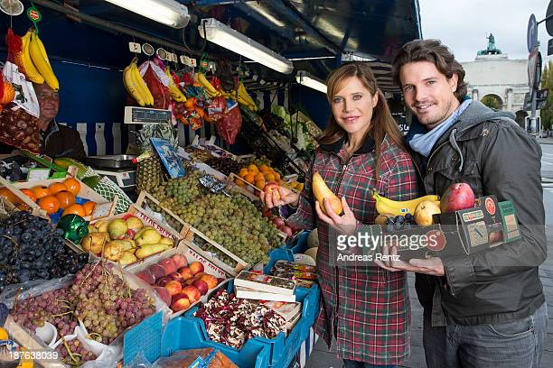 Doreen Dietel and her partner Tobias Guttenberg pose during a portrait session announcing her pregnancy at a fruit stand on November 9 2013 in Munich...