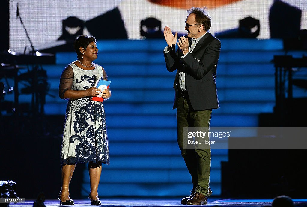 Doreen Lawrence on stage with Danny Boyle at 'Unity: A Concert For Stephen Lawrence' in aid of The Stephen Lawrence Charitable Trust at the O2 Arena on September 29, 2013 in London, England.