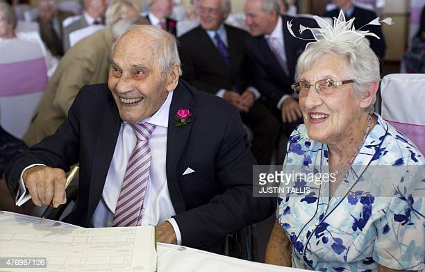 Doreen Luckie aged 91 and George Kirby aged 103 sign the register during their wedding ceremony at the Langham Hotel in Eastbourne southern England...