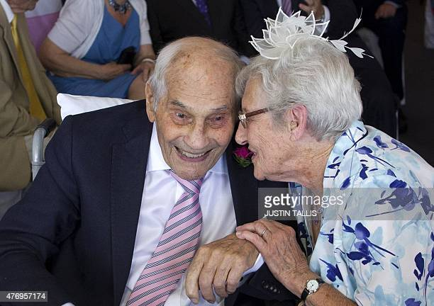 Doreen Luckie aged 91 and George Kirby aged 103 talk as they sign the registry book during their wedding ceremony at the Langham Hotel in Eastbourne...