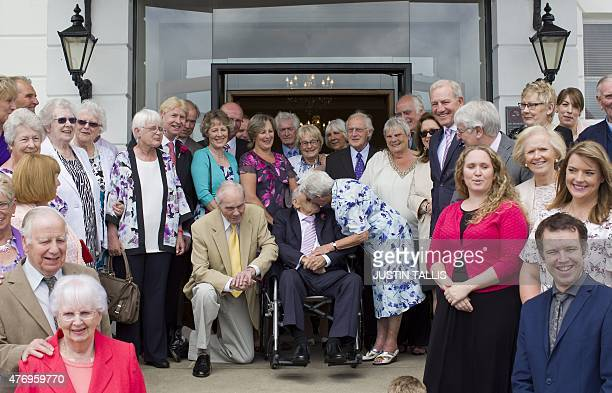 Doreen Luckie , aged 91, kisses her husband George Kirby , aged 103, as they pose for photographers after their wedding ceremony with guests on the...