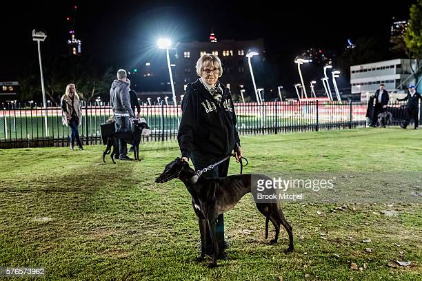 Doreen with her dog Magic Lace at Wentworth Park on July 16 2016 in Sydney Australia Greyhound Racing in NSW has now resumed after a week suspension...
